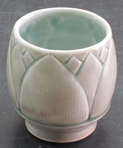 "Lotus flower shaped teabowl.  3-4"" tall.   This is a little different from my other wares, but I really love the form, and I developed the tinted transparent glaze especially to show off this sort of fine surface detail."