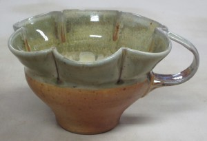 "Cup shape based on late Medieval/ early Renaissance English cup.  Soda fired.  Less that 3"" tall."