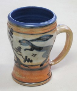 "decorated mug with bunny & oak tree design; 4.5 – 5"" tall."