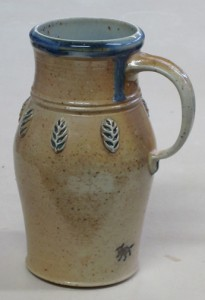 Soda fired tankard with wheat-ear sprigs (applied, raised decoration).  Based on medieval English form and decoration.