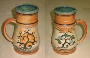 Tankard with tree design: winter tree w/moon on one face, summer tree w/ sun on the opposite side. *